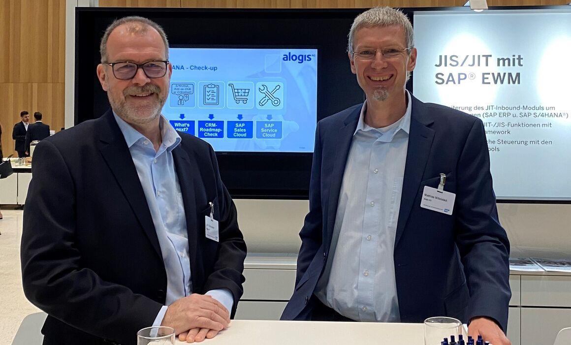 Jörn Samuelson (Vorstand, l.) und Matthias Mittelstädt (Prokurist und Senior Project Manager, r.) der alogis AG auf dem SAP-Infotag für Lager- und Transportmanagement 2019